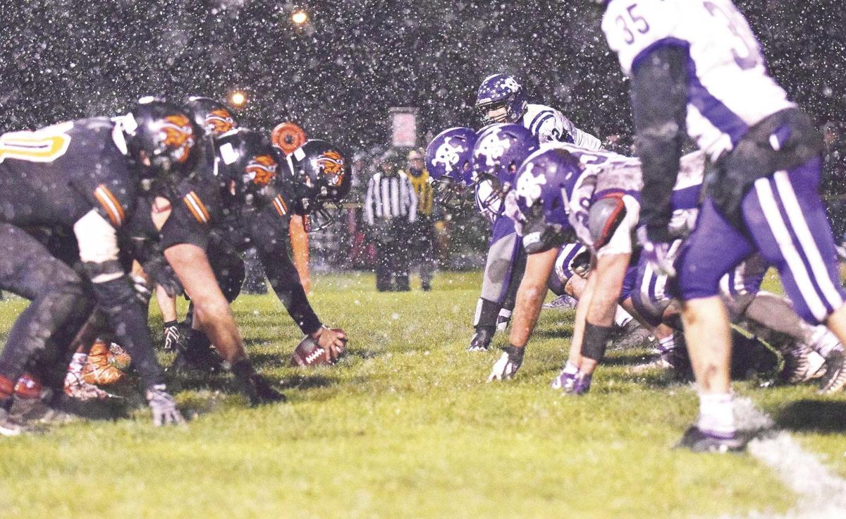 GB-FB-Tiger's-and-Pirates-squaring-off-in-the-snow-last-Friday-night!.jpg