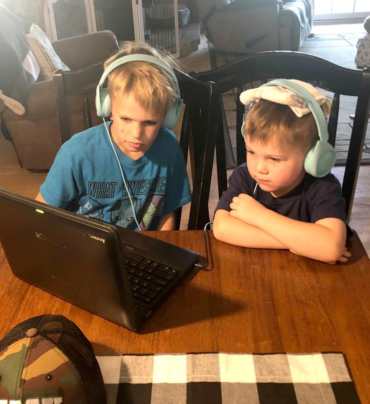 A first grader shares his Chromebook with a 3-year-old at Mother Hen's Farmhouse Friends in Valley Springs.
