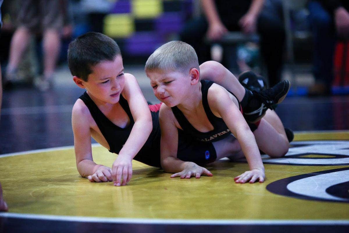 Young grapplers show off their skills while competing in tourney