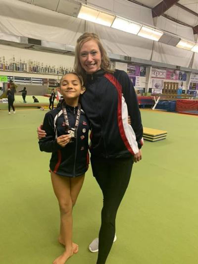 Art of Gymnastics & Cheer Celebrate Wins at First Meet of the Season