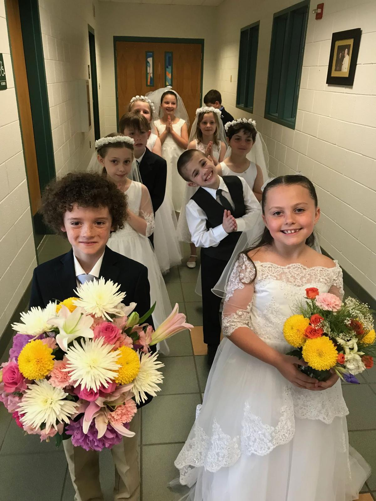 Bishop McHugh Students Crown Blessed Mother in May Procession
