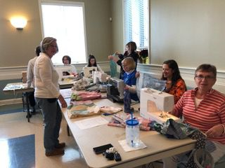 Seamstresses at St. Paul Church Sew Dresses for Third World Girls
