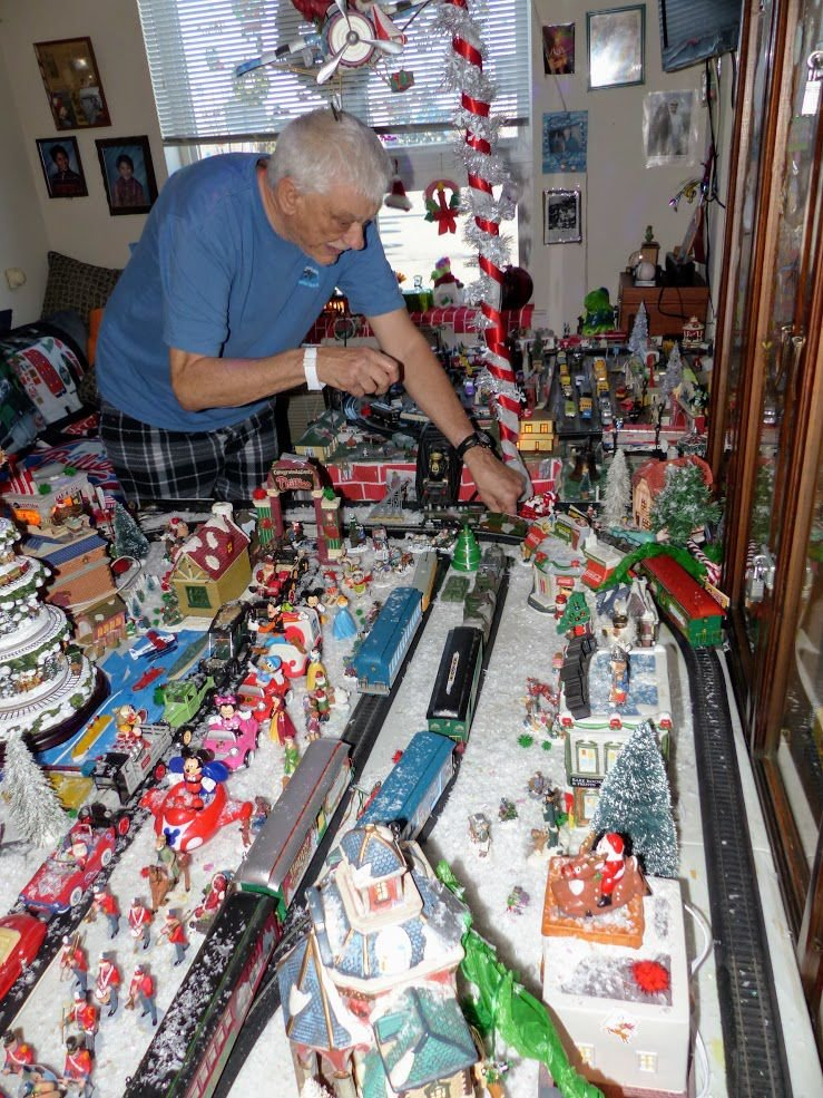 Frank Dachowski fixes his model train village set up especially for Christmas.