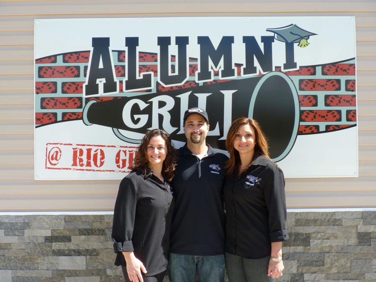 Jennifer Robinson, Michael DeClemente and Michele Hughes, franchise owners of Alumni Grill.