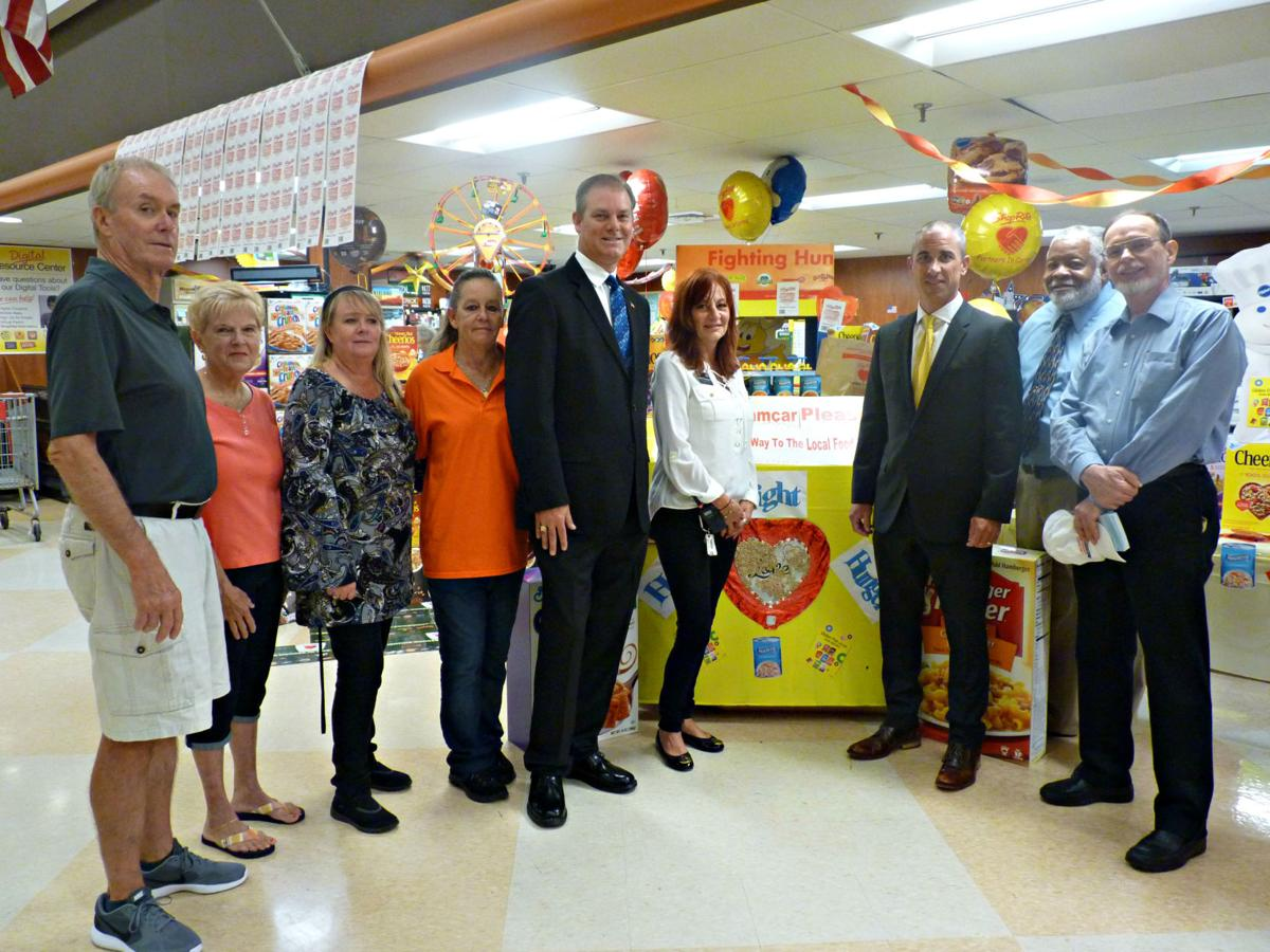 Shoprite fights hunger with help from local dignitaries business local community leaders and dignitaries come together for shoprites bag for hunger day falaconquin