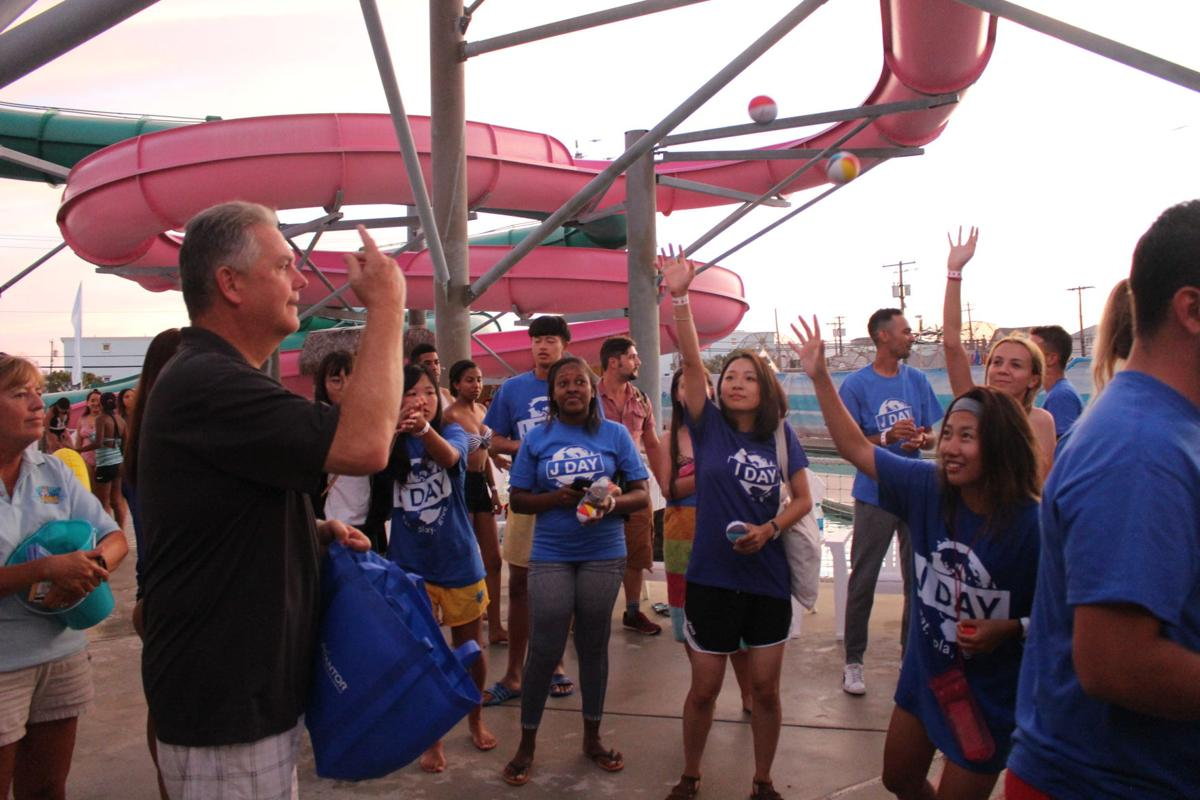 John Lynch throws beach balls that     students who catch them can trade for prizes during J Day at Splash Zone     Waterpark.JPG
