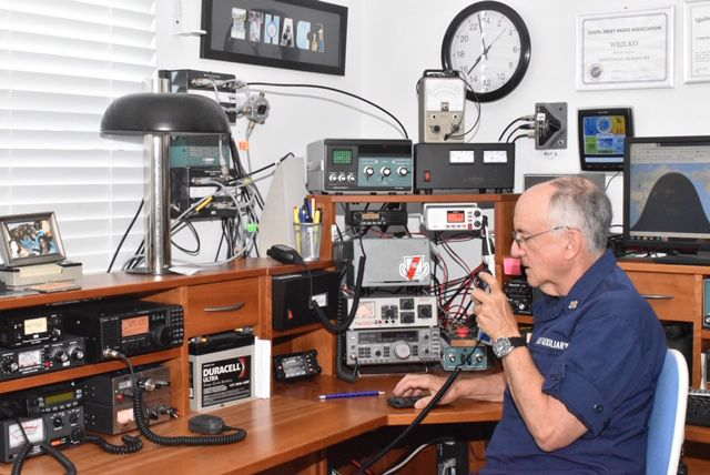 Coast Guard Auxiliarists Maintain Radio Communication with Auxiliary Aircraft