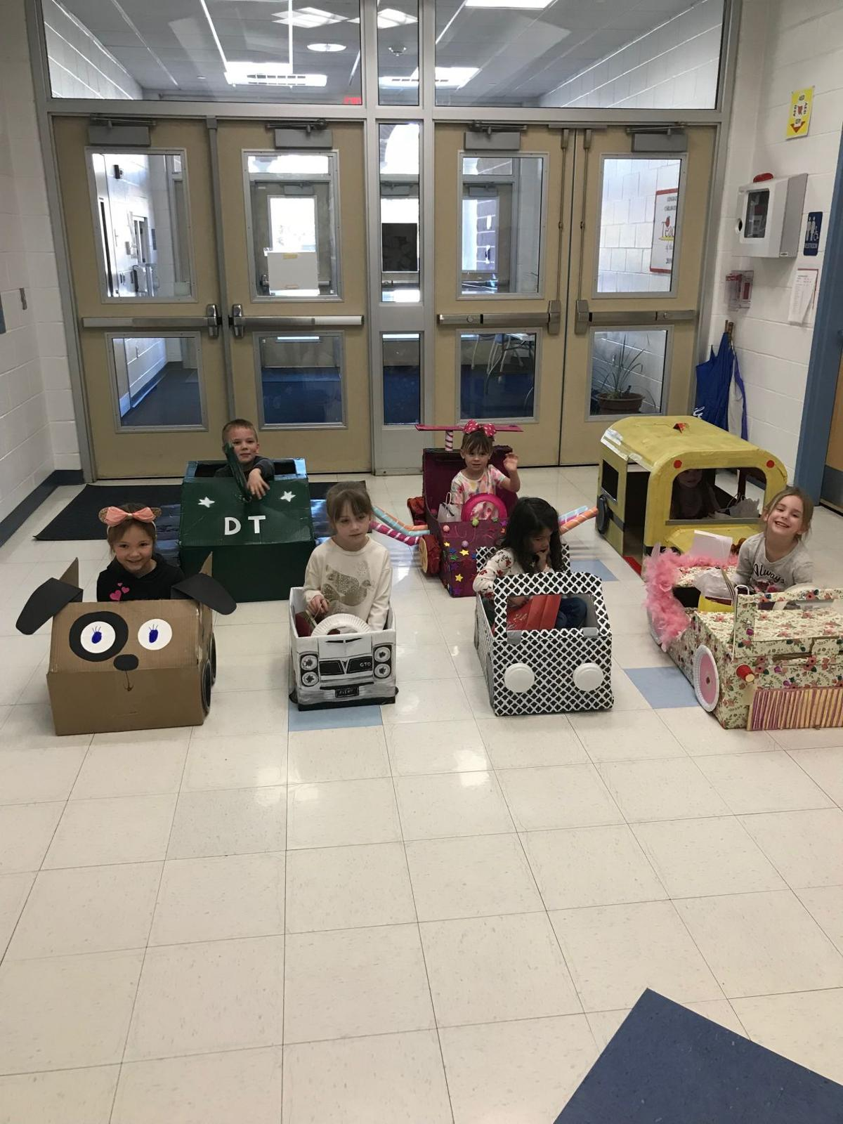 Dennis Students Watch 'Drive-in Movie' from Cardboard Cars