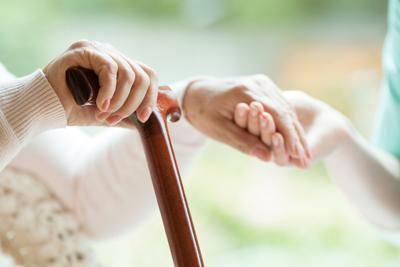Closeup,Of,Elderly,Lady,Holding,Walking,Cane,In,One,Hand