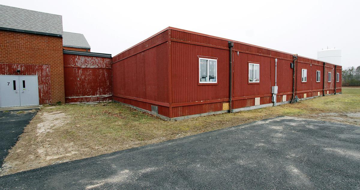 Modular Classroom Moving ~ Forestdale portables require additional work before