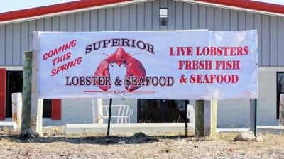 A Banner Announces Superior Lobster Company On Gallo Road In Sandwich