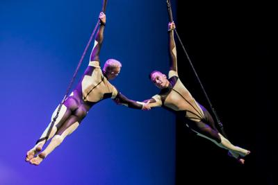P Town Circus E & B holding hands flying