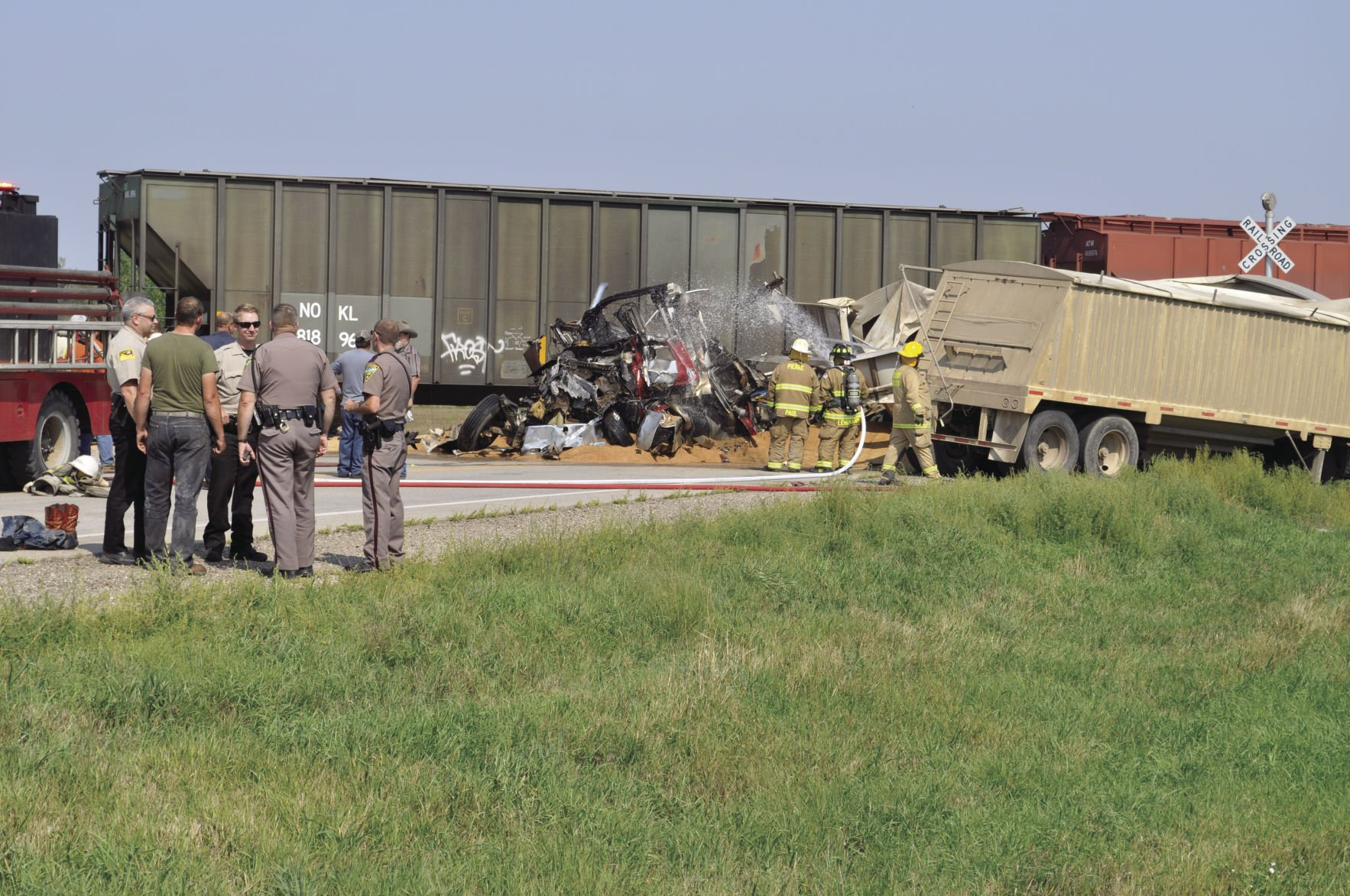 Volunteer Firefighters From Blunt Pour Water On The Mangled Cab Of A  Semi Truck Tractor That Crashed Into The Locomotive Of A RCPE Grain Train  About 3 P.m., ...