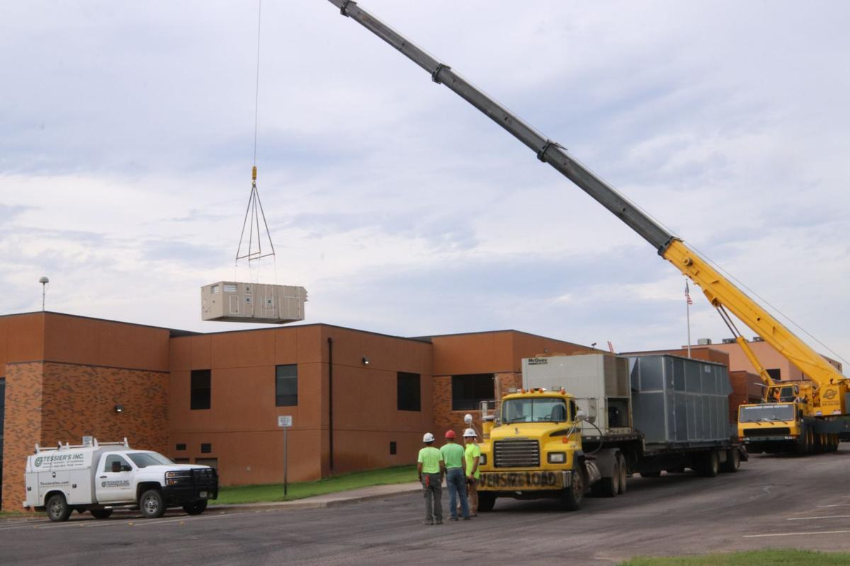 Done with the heavy lifting part of aquatic center's new HVAC units