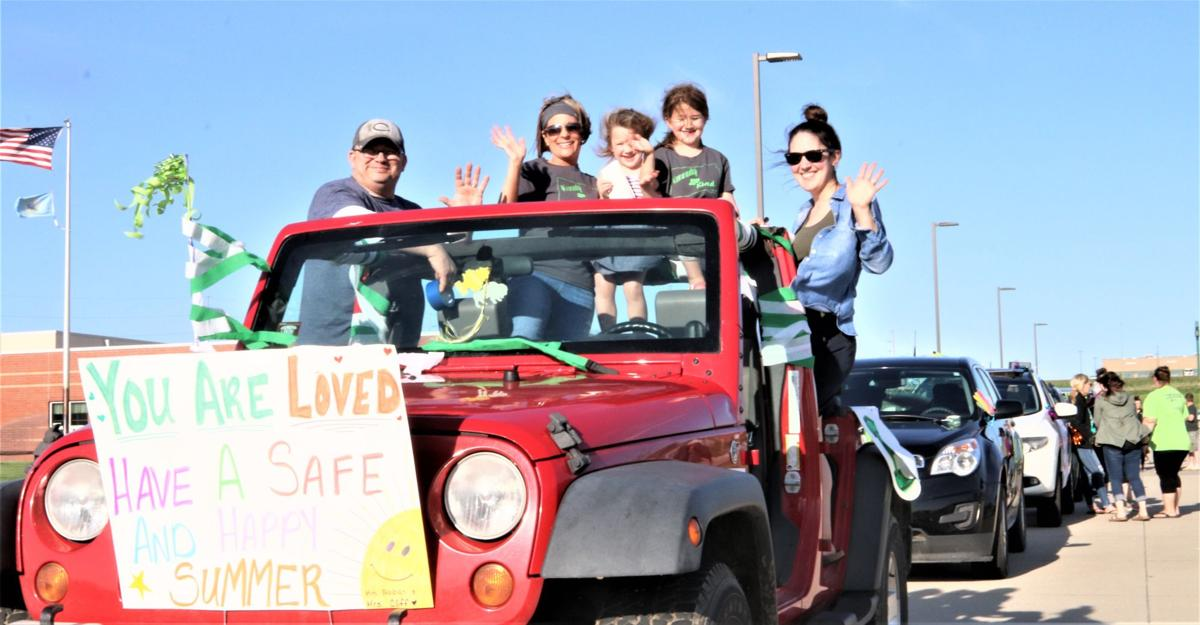 Kennedy Elementary staff drives congratulatory parade for students