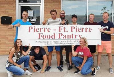 International exchange volunteers help at Pierre Area Referral Service
