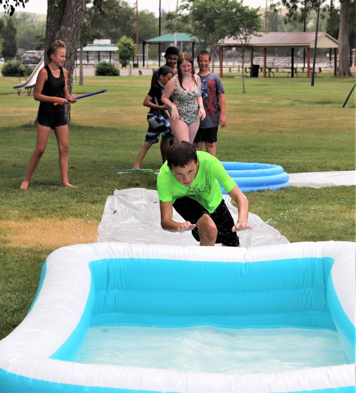 City youth slip-n-slide kickball