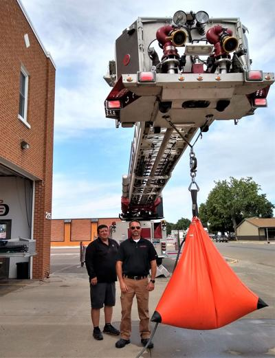 Annual ladder truck testing a weighty process