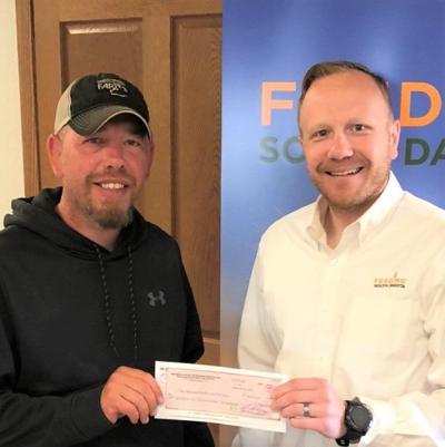 Christensen Farms donates $1,000 to local food bank