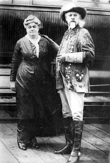 Buffalo Bill and wife by train Kent's Studio, Chehalis, Wash..jpg