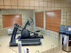 Exercise Room with treadmill and elliptical