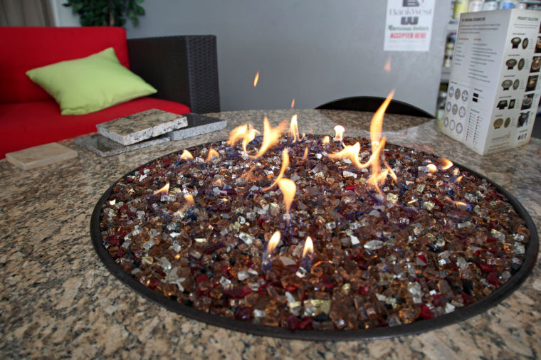 An Oriflamme Fire Table With A Traditional Style Fire Is On Display At  Local Retailer Leisure Palace.