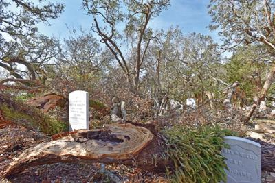 Hurricane damage includes debris, broken headstones