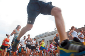 <p>Runners pound the pavement in 2012 during the Beaufort Ole Towne Rotary Club's 33rd annual Historic Beaufort Road Race. The 2013 race is July 20 in downtown Beaufort. (Dylan Ray photo)</p>
