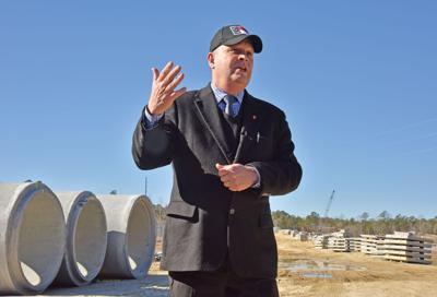 Cites Morehead City bridge replacement, upgrades to Highway 70