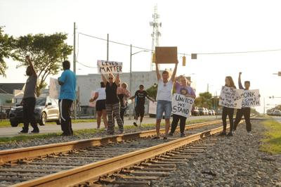 Small group of demonstrators gather in downtown Morehead City