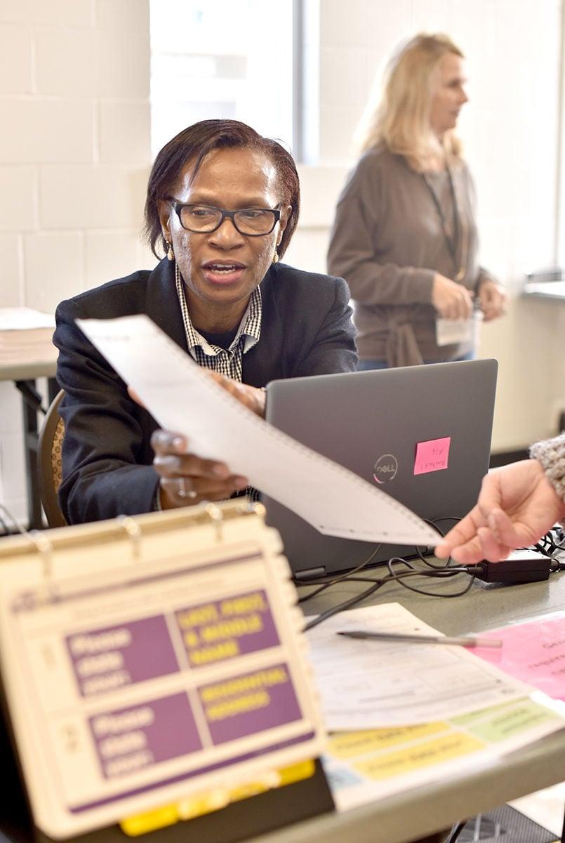 Election judge helps voter