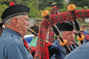 <p>Andy Simpson, right, with the Port City Pipes and Drums of Wilmington, serenades the crowd with traditional tunes from pipes at Emerald Plantation during a previous festival. (Dylan Ray photo)</p>