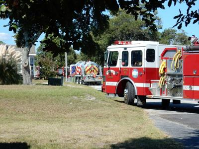 Outside fire on Harkers Island spreads to camper Sunday