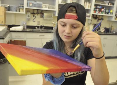 Catherine Todd paints Friday in the East Carteret High School art room