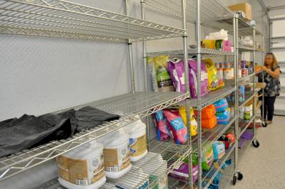 PAWS seeks donations to restock pet food pantry; still awaiting Florence insurance settlement