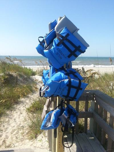 Donors outfit beachgoers with life jackets