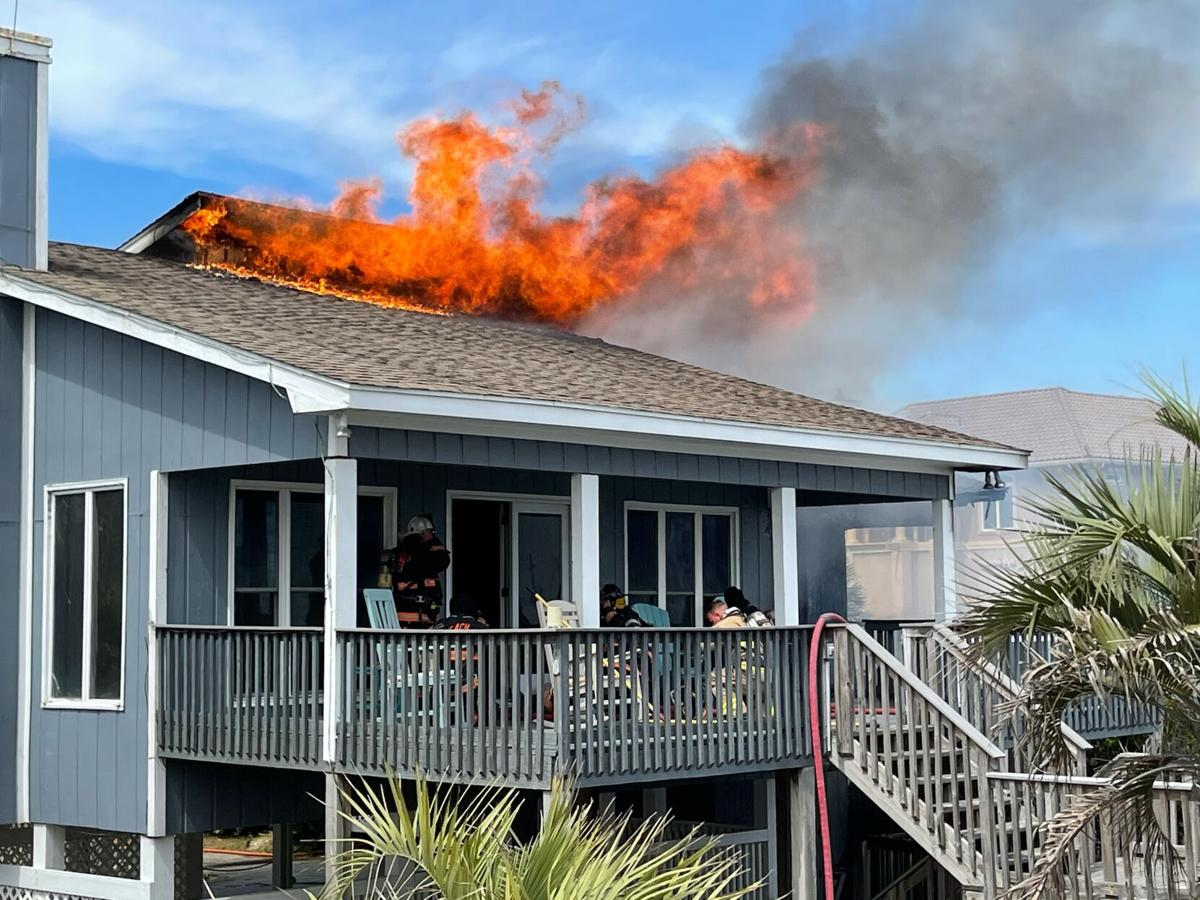 Emerald Isle, other fire crews work to put out house fire
