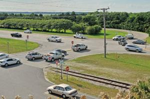 <p>Drivers leaving Pivers Island and Radio Island jockey for position as east and westbound traffic flows along Old Causeway Road. (Dylan Ray photo)</p><p></p>