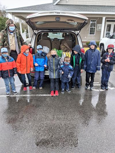 Scouts weather rainy conditions during food pickup