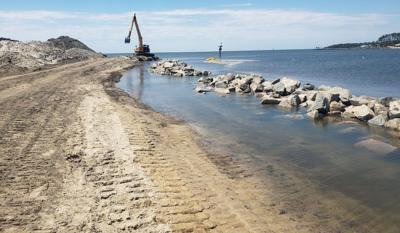 Contractor works to finish Atlantic Harbor granite sill