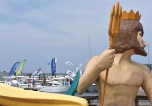 <p>Neptune from Olympus Dive Center watches over the Jaycee Park and Morehead City town docks during the 11th annual Crystal Coast Boat Show Saturday. (Dylan Ray photo)</p><p></p>