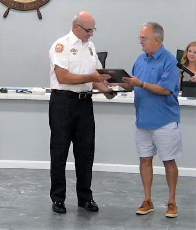 Emerald Isle honors retired fire department captain with Order of the Long Leaf Pine