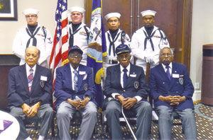 <p>From left, members of the U.S. Navy B-1 Bandsmen, Calvin Morrow, the late Abe Thurman, John Mason and Simeon Holloway, sit with members of the U.S. Navy color guard at their 2015 reunion. A historical marker has been placed in Chapel Hill to honor the band. (File photo)</p>