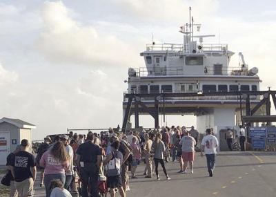 Volunteers board Cedar Island Ferry