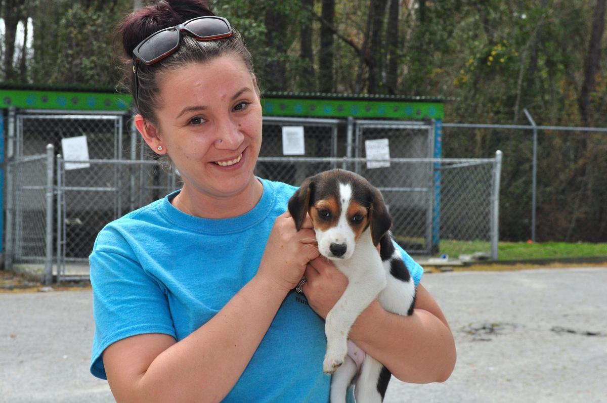 2worker holds adopted puppycb.jpg