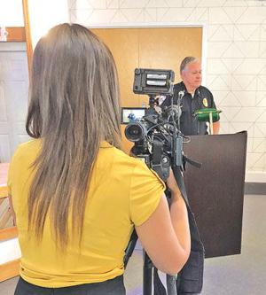 "<p class=""p1""><span class=""s1"">Ken Jackson, chief of the Swansboro Police Department, shares details on upcoming traffic-control measures at a Monday, July 16, press conference while being filmed by Merrilee Moore of WCTI-TV Channel 12. Motorists need to be aware that stricter enforcement measures are now in place. For details, purchase a copy of the July 18, 2018, Tideland News. (Williams photo)</span></p>"