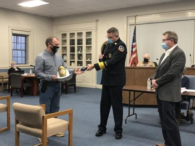 Morehead City presents Judy with helmet, badge upon retirement from fire department