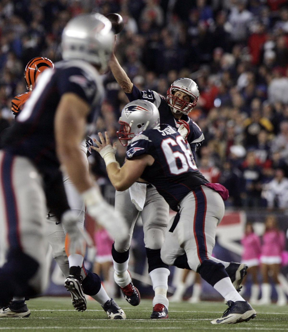 New England Patriots quarterback Tom Brady rifles a pass over the middle to tight end Rob Gronkowski at the end of the second quarter of play.