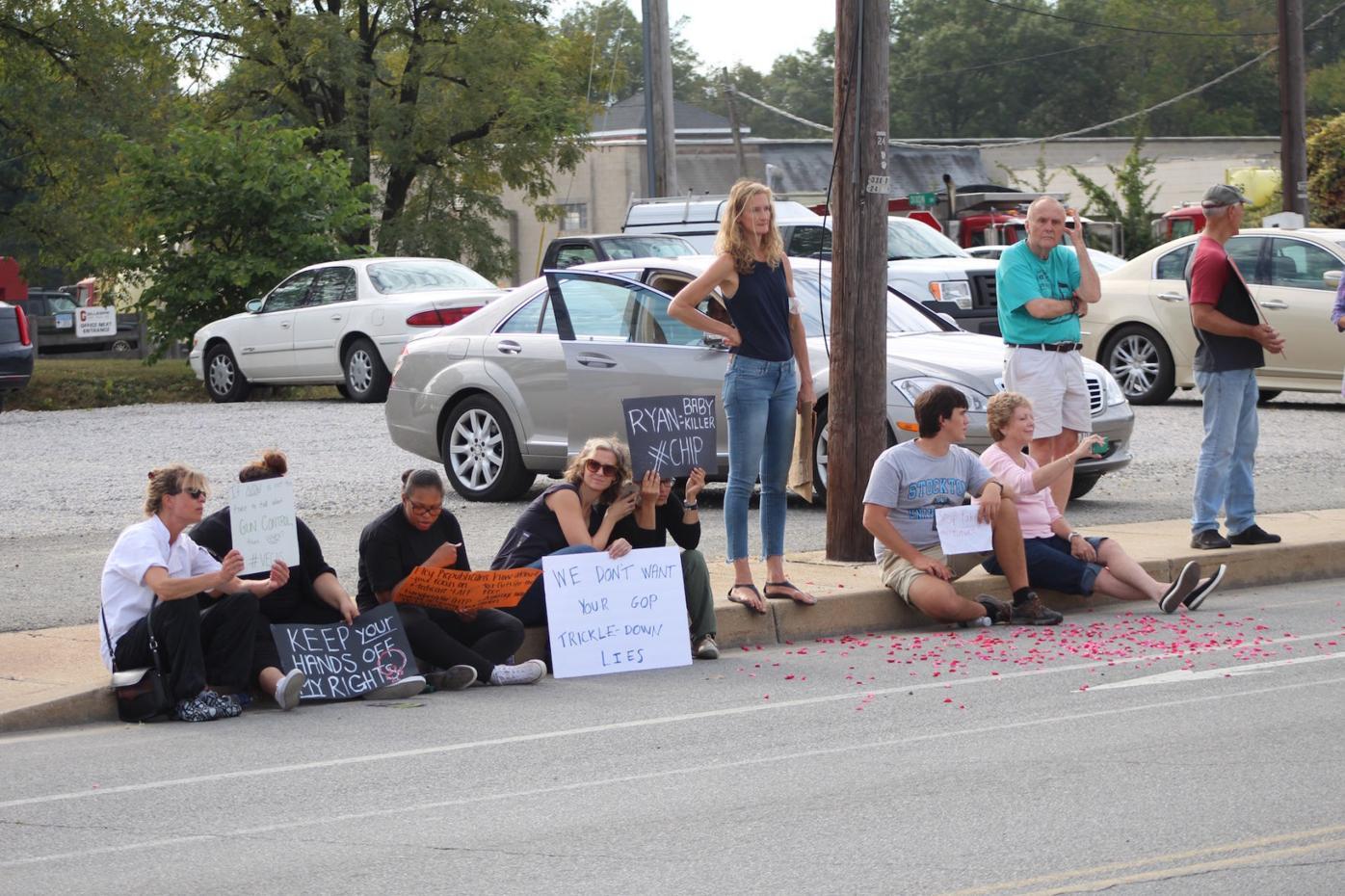 Protesting House Speaker Paul Ryan's visit to Dixon Valve & Coupling