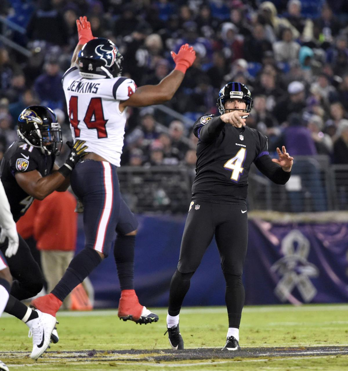baltimore ravens sam koch 4 throws a pass for a first down after the ravens faked a punt in the second quarter against the houston texans on monday at